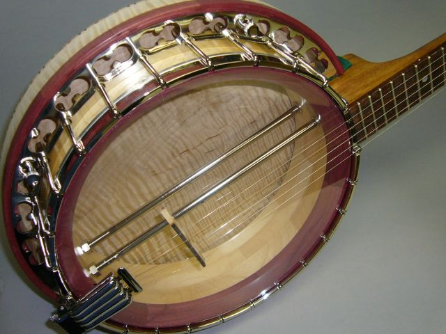Maple rim and figured maple resonator. Purpleheart tonering. Dual Coordinator rods and clamshell tailpiece.